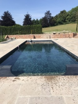 Curved swimming pool steps and bbq area